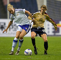 USWNT midfielder (10) Angie Woznuk fights for the ball with Finland's (8) Leena Puranen during the Four Nations Tournament in  Guangzhou, China.  The US defeated Finland, 4-1.