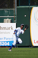 South Bend Cubs center fielder Roberto Caro (43) catches a fly ball during the second game of a doubleheader against the Peoria Chiefs on July 25, 2016 at Four Winds Field in South Bend, Indiana.  South Bend defeated Peoria 9-2.  (Mike Janes/Four Seam Images)