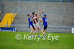 Causeway's Muiris Delaned bottled up by St Brendans Cian Hussey and Brendan O'Connor in the County Senior Hurling championship