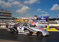 Aug 15, 2014; Brainerd, MN, USA; NHRA funny car driver Jack Beckman (near lane) races alongside Bob Tasca III during qualifying for the Lucas Oil Nationals at Brainerd International Raceway. Mandatory Credit: Mark J. Rebilas-
