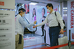 A shop staff checks the temperature of a customer on the day of Japan's Prime lift of the state of emergency in Tokyo and the remaining 5 areas still under alert for the coronavirus disease (COVID-19) at Shinjuku district in Tokyo, Japan May 25, 2020. May 25, 2020 (Photo by Nicolas Datiche/AFLO) (JAPAN) FRANCE OUT