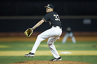 Wake Forest Demon Deacons relief pitcher Ryan Cusick (33) in action against the Illinois Fighting Illini at David F. Couch Ballpark on February 16, 2019 in  Winston-Salem, North Carolina.  The Fighting Illini defeated the Demon Deacons 5-2. (Brian Westerholt/Four Seam Images)