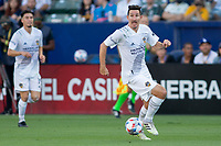 CARSON, CA - JUNE 19: Sacha Kljestan #16 of the Los Angeles Galaxy looking for an open man during a game between Seattle Sounders FC and Los Angeles Galaxy at Dignity Health Sports Park on June 19, 2021 in Carson, California.