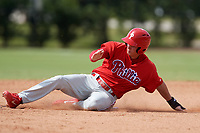 Philadelphia Phillies Mickey Moniak (15) slides into third base during an Instructional League game against the Atlanta Braves on October 9, 2017 at the Carpenter Complex in Clearwater, Florida.  (Mike Janes/Four Seam Images)