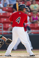 Travis Adair #4 of the Hickory Crawdads at bat against the Greensboro Grasshoppers at  L.P. Frans Stadium July 10, 2010, in Hickory, North Carolina.  Photo by Brian Westerholt / Four Seam Images