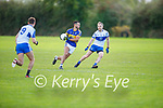 Glenflesk's Jeff O'Donoghue tries to side step Maurice Hickey of Castleisland Desmonds in the Intermediate Football Club Championship