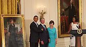United States President Barack Obama (left), former U.S. President George W. Bush (2nd left), former first lady Laura Bush (2nd right) and first lady Michelle Obama (right) joke around at the unveiling of the official White House Bush portraits at the White House in Washington, DC, Thursday, May 31, 2012. .Credit: Chris Kleponis / CNP