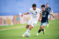 LAKE BUENA VISTA, FL - JULY 23: Mauricio Pineda #22 of the Chicago Fire dribbles the ball during a game between Chicago Fire and Vancouver Whitecaps at Wide World of Sports on July 23, 2020 in Lake Buena Vista, Florida.