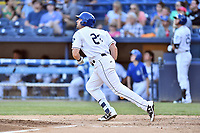 Asheville Tourists first baseman Chad Spanberger (24) runs to first base during a game against the Greensboro Grasshoppers at McCormick Field on May 10, 2018 in Asheville, North Carolina. The Tourists defeated the Grasshoppers 14-10. (Tony Farlow/Four Seam Images)