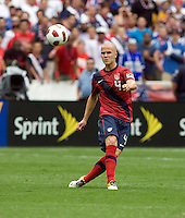 Michael Bradley (4) of the USMNT  flights the ball forward during the game at RFK Stadium in Washington, DC.  The USMNT defeated Jamaica, 2-0.