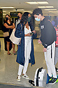 MIAMI, FL - JULY 15: (EXCLUSIVE COVERAGE) Garcelle Beauvais (L) is seen at Miami International Airport with her son Jaid Thomas Nilon on July 15, 2021 in Miami, Florida.  (Photo by Vallery Jean / jlnphotography.com )