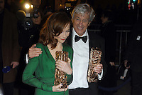 PARIS, FRANCE - FEBRUARY 24: Isabelle Huppert and Paul Verhoeven attend the Red Carpet Arrivals during the Cesar Film Awards 2017 at Le Fouquet's on February 24, 2017 in Paris, France