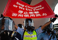Hong Kong police prepare to fire tear gas at pro-democracy protesters during the first day of the mass civil disobedience campaign Occupy Central, Hong Kong, China, 28 September 2014.