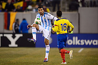 Argentina defender Ezequiel Garay (2) plays the ball. Argentina and Ecuador played to a 0-0 tie during an international friendly at MetLife Stadium in East Rutherford, NJ, on November 15, 2013.
