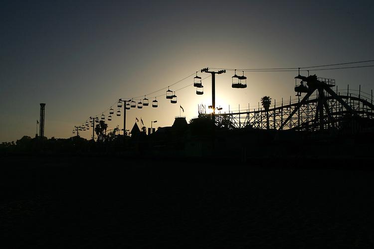May 21, 2007; Santa Cruz, CA, USA; The sun sets behind the Santa Cruz Beach Boardwalk in Santa Cruz, CA. Photo by: Phillip Carter