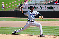 West Michigan Whitecaps relief pitcher Xavier Javier (33) throws a pitch during a game against the Wisconsin Timber Rattlers on May 22, 2021 at Neuroscience Group Field at Fox Cities Stadium in Grand Chute, Wisconsin.  (Brad Krause/Four Seam Images)