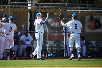 South Dakota State Jackrabbits pitcher Tyler Olmstead (28) high fives Logan Holtz (6) during a game against the FIU Panthers on February 23, 2019 at North Charlotte Regional Park in Port Charlotte, Florida.  South Dakota State defeated FIU 4-3.  (Mike Janes/Four Seam Images)