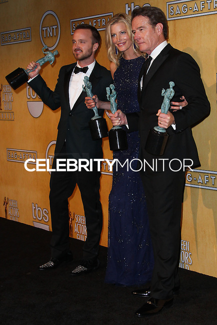LOS ANGELES, CA - JANUARY 18: Aaron Paul, Anna Gunn, Bryan Cranston in the press room at the 20th Annual Screen Actors Guild Awards held at The Shrine Auditorium on January 18, 2014 in Los Angeles, California. (Photo by Xavier Collin/Celebrity Monitor)