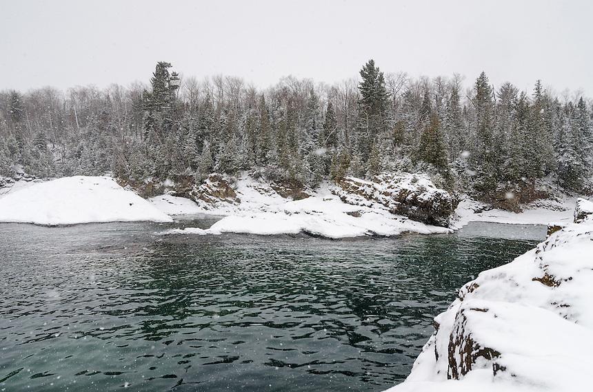 Fresh snow falling along the Lake Superior shoreline at Presque Isle park. Marquette, MI