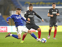 26th December 2020; Cardiff City Stadium, Cardiff, Glamorgan, Wales; English Football League Championship Football, Cardiff City versus Brentford; Joe Bennett of Cardiff City tackles Emiliano Marcondes of Brentford whilst missing his left boot in an earlier challenge