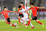 Akram Hassan Afif of Qatar (C) fights for the ball with Lee Yong of South Korea (R) and Lee Seungwoo of South Korea (L) during the AFC Asian Cup UAE 2019 Quarter Finals match between Qatar (QAT) and South Korea (KOR) at Zayed Sports City Stadium  on 25 January 2019 in Abu Dhabi, United Arab Emirates. Photo by Marcio Rodrigo Machado / Power Sport Images