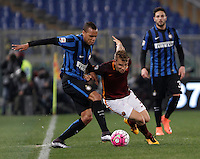 Calcio, Serie A: Roma vs Inter. Roma, stadio Olimpico, 19 marzo 2016.<br /> FC Inter's Jonathan Biabiany, left and Roma's Lucas Digne fight for the ball during the Italian Serie A football match between Roma and FC Inter at Rome's Olympic stadium, 19 March 2016. The game ended 1-1.<br /> UPDATE IMAGES PRESS/Isabella Bonotto