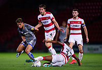 Lincoln City's Tyler Walker vies for possession with Doncaster Rovers' Cameron John<br /> <br /> Photographer Andrew Vaughan/CameraSport<br /> <br /> EFL Leasing.com Trophy - Northern Section - Group H - Doncaster Rovers v Lincoln City - Tuesday 3rd September 2019 - Keepmoat Stadium - Doncaster<br />  <br /> World Copyright © 2018 CameraSport. All rights reserved. 43 Linden Ave. Countesthorpe. Leicester. England. LE8 5PG - Tel: +44 (0) 116 277 4147 - admin@camerasport.com - www.camerasport.com