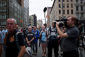 New  York, New York.September 11, 2011..Crowds gather at Church Street and Park Place, two block from Ground Zero, to mark the 10th anniversary of 9-11-2001 tragic attack on the US. The entire area was under extremely heave police presents during the day. Visitors listen as the names of the more then three thousand victims, who died on that day, are read.