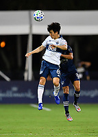LAKE BUENA VISTA, FL - JULY 26: Hwang In-Beom of Vancouver Whitecaps FC heads the ball to a teammate during a game between Vancouver Whitecaps and Sporting Kansas City at ESPN Wide World of Sports on July 26, 2020 in Lake Buena Vista, Florida.