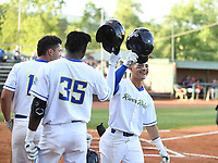 John Montes (12) (Central Florida) of the Elizabethton River Riders is met by teammates following his home run during a game against the Greeneville Flyboys on June 4, 2021 at Northeast Community Credit Union Ballpark in Elizabethton, Tennessee. (Tracy Proffitt/Four Seam Images)