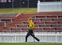 Peter Younghusband catches Henry Cooper on the boundary to finish the Ford Trophy men's cricket match between Wellington Firebirds and Northern Districts at the Basin Reserve in Wellington, New Zealand on Sunday, 21 February 2021. Photo: Dave Lintott / lintottphoto.co.nz