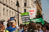 Marchers hold placards aloft at the Climate Change demonstration, London, 21st September 2014. © Sue Cunningham