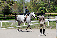 Young girl competes in horse jumping in Middleburg, Virginia