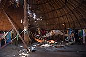 Xingu Indigenous Park, Mato Grosso, Brazil. Aldeia Matipu. Guests' hammocks inside a traditional oca house.