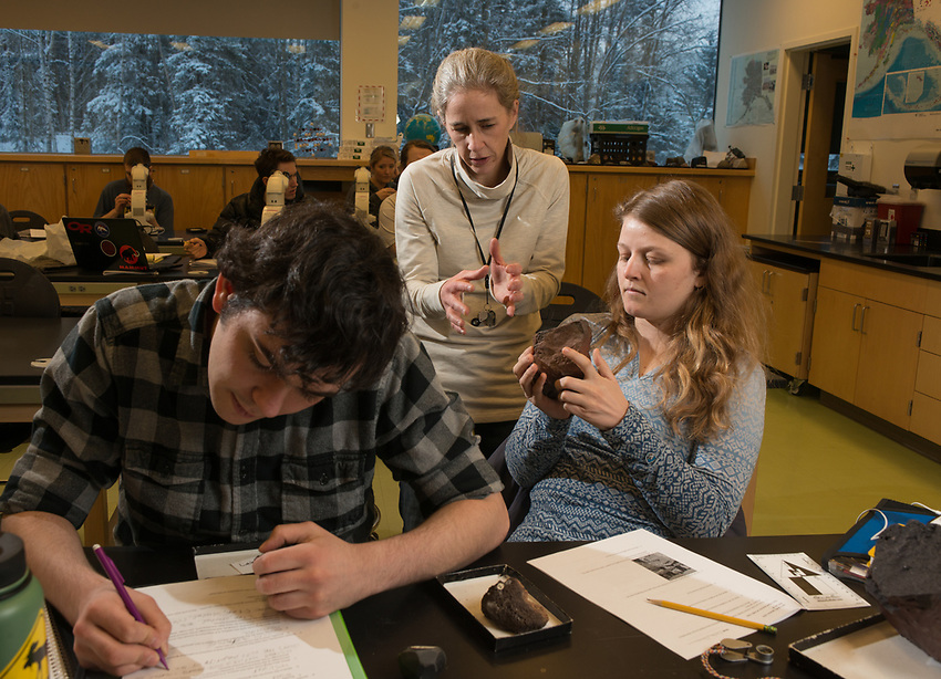 Geology Professor Erin Shea helps Monika Fleming and Zach Spath interpret a rock sample as she teaches Igneous and Metamorphic Petrology (GEOL A322) in UAA's ConocoPhillips Integrated Science Building. Students in GEOL A322 learn to identify and classify igneous and metamorphic rocks; interpret different rock textures, structures, and mineralogy; and learn about the chemical and physical principles that control the formation of rocks.