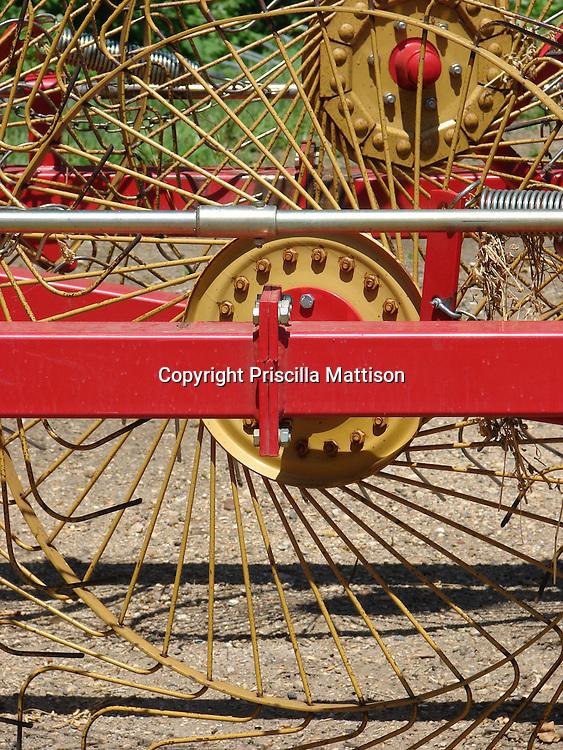Closeup on a wheel of a hay rake.