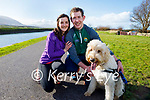 Bell the dog being taken for a walk by Clare Daly and Fionn Murray in Blennerville on Sunday.