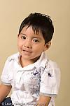 closeup headshot portrait of boy age 4 or 5 preschool age vertical