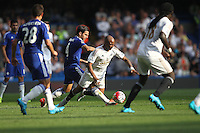 Andre Ayew of Swansea is fouled by Cesc Fabregas of Chelsea   during the Barclays Premier League match between  Chelsea and Swansea  played at Stamford Bridge, London