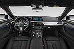Stock photo of straight dashboard view of 2019 BMW 5-Series - 5 Door Wagon Dashboard