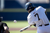 Michigan Wolverines first baseman Jake Marti (7) swings the bat during the NCAA baseball game against the Illinois Fighting Illini on March 20, 2021 at Fisher Stadium in Ann Arbor, Michigan. Michigan won the game 8-1. (Andrew Woolley/Four Seam Images)