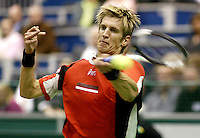 25-2-06, Netherlands, tennis, Rotterdam, ABNAMROWTT, Jarkko Nieminen in action against Oliver Rochus