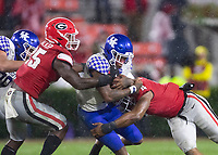 ATHENS, GA - OCTOBER 19: Lynn Bowden Jr. #1 of the Kentucky Wildcats is tackled by Quay Walker #25 and Nolan Smith #4 of the Georgia Bulldogs during a game between University of Kentucky Wildcats and University of Georgia Bulldogs at Sanford Stadium on October 19, 2019 in Athens, Georgia.