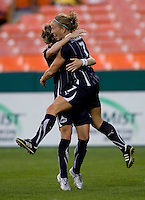 Sonia Bompastor (8) of the Washington Freedom celebrates the goal of teammate Lene Mykjaland (7) with her at RFK Stadium in Washington, DC.  The Washington Freedom defeated Saint Louis Athletica, 3-1.