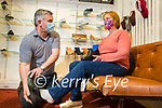 Ann Woulfe from Kilmorna, Listowel trying on new shoes with a helping hand from Con Whelan of Whelans Shoes Listowel on Monday.