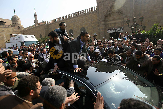 Palestinian prime minister in Gaza Strip, Ismail Haniya (inside car) greets supporters as he leaves following Friday noon prayer at Al-Azhar mosque, in Cairo, Egypt, 24 February 2012. According to media reports, Haniyeh joined hundreds of Egyptians gathering at Al-Azhar Mosque on 24 February to show solidarity with the Palestinians against Israeli settlers' attacks on Al-Aqsa mosque. The gathering also aimed at showing support to the Syrian people. Photo by Osama Hamamm
