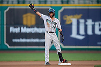 Dayton Dragons Allan Cerda (24) gestures to his teams bench after hitting a double during a game against the Fort Wayne TinCaps on August 25, 2021 at Parkview Field in Fort Wayne, Indiana.  (Mike Janes/Four Seam Images)