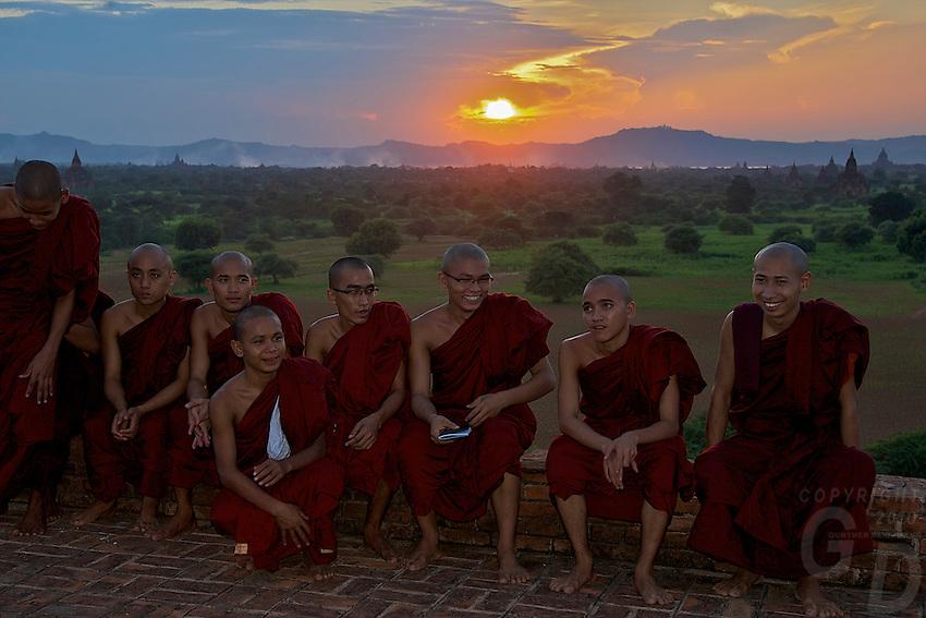 Monks enjoying the sunset at the Pyat That Gys temple Bagan Myanmar