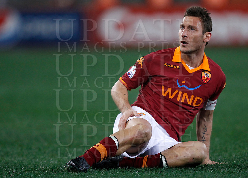 Calcio, semifinale di andata di Coppa Italia: Roma vs Inter. Roma, stadio Olimpico, 23 gennaio 2013..AS Roma forward Francesco Totti sits on the pitch during the Italy Cup football semifinal first half match between AS Roma and FC Inter at Rome's Olympic stadium, 23 January 2013..UPDATE IMAGES PRESS/Isabella Bonotto
