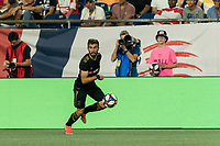 FOXBOROUGH, MA - AUGUST 4: Diego Rossi #9 of Los Angeles FC dribbles down the wing during a game between Los Angeles FC and New England Revolution at Gillette Stadium on August 3, 2019 in Foxborough, Massachusetts.